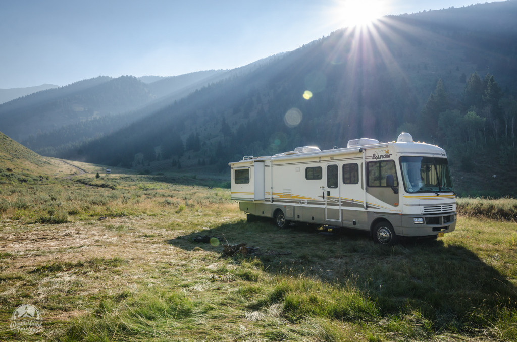 RV parked in a sweeping green valley