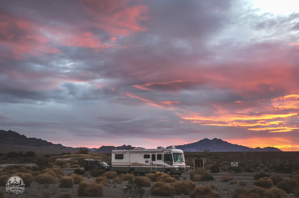 RV with colorful sunrise and mountains