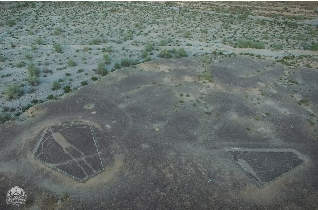 Aerial view of geoglyphs: human figure and animals