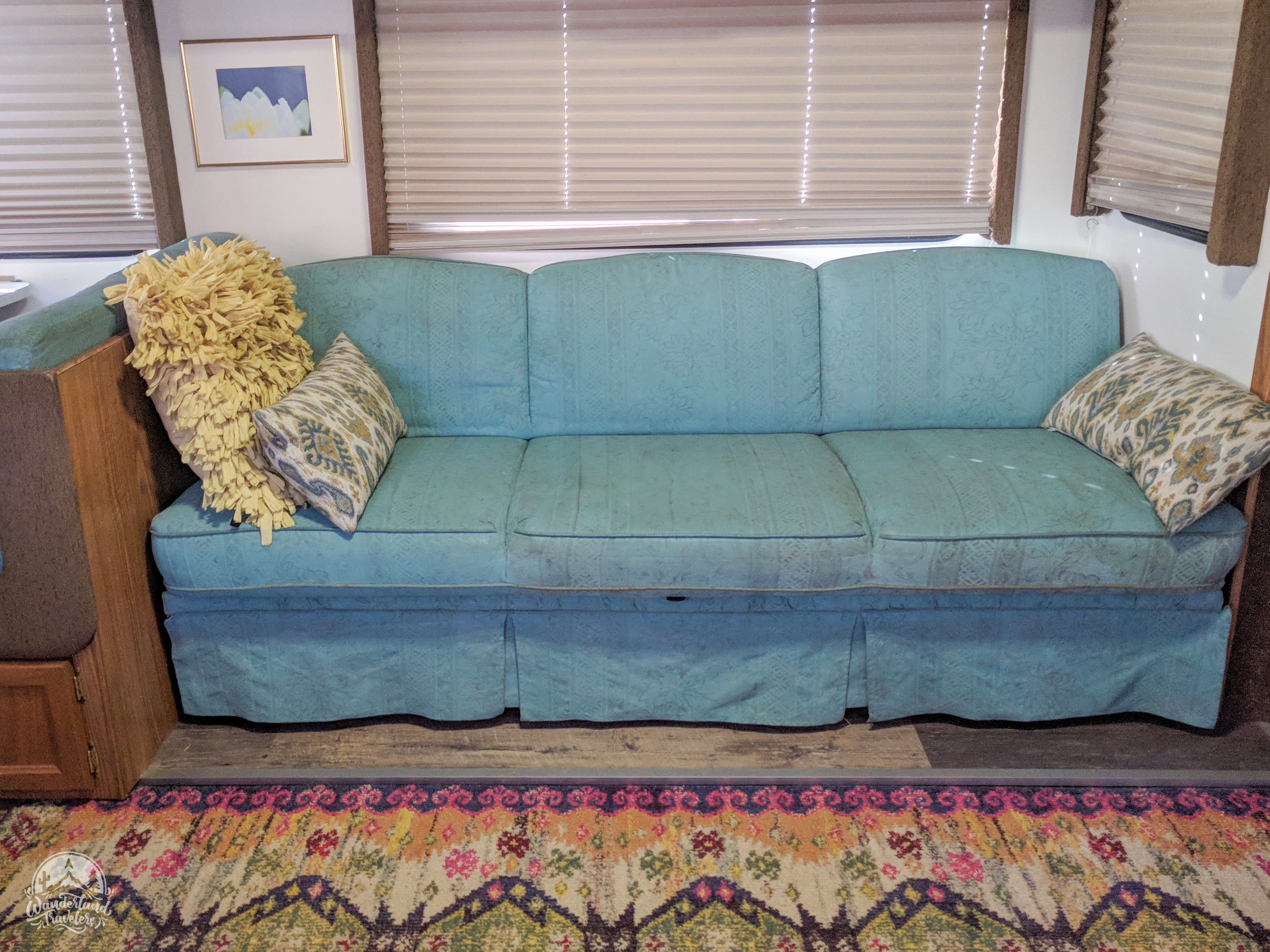 a blue couch painted with chalk paint