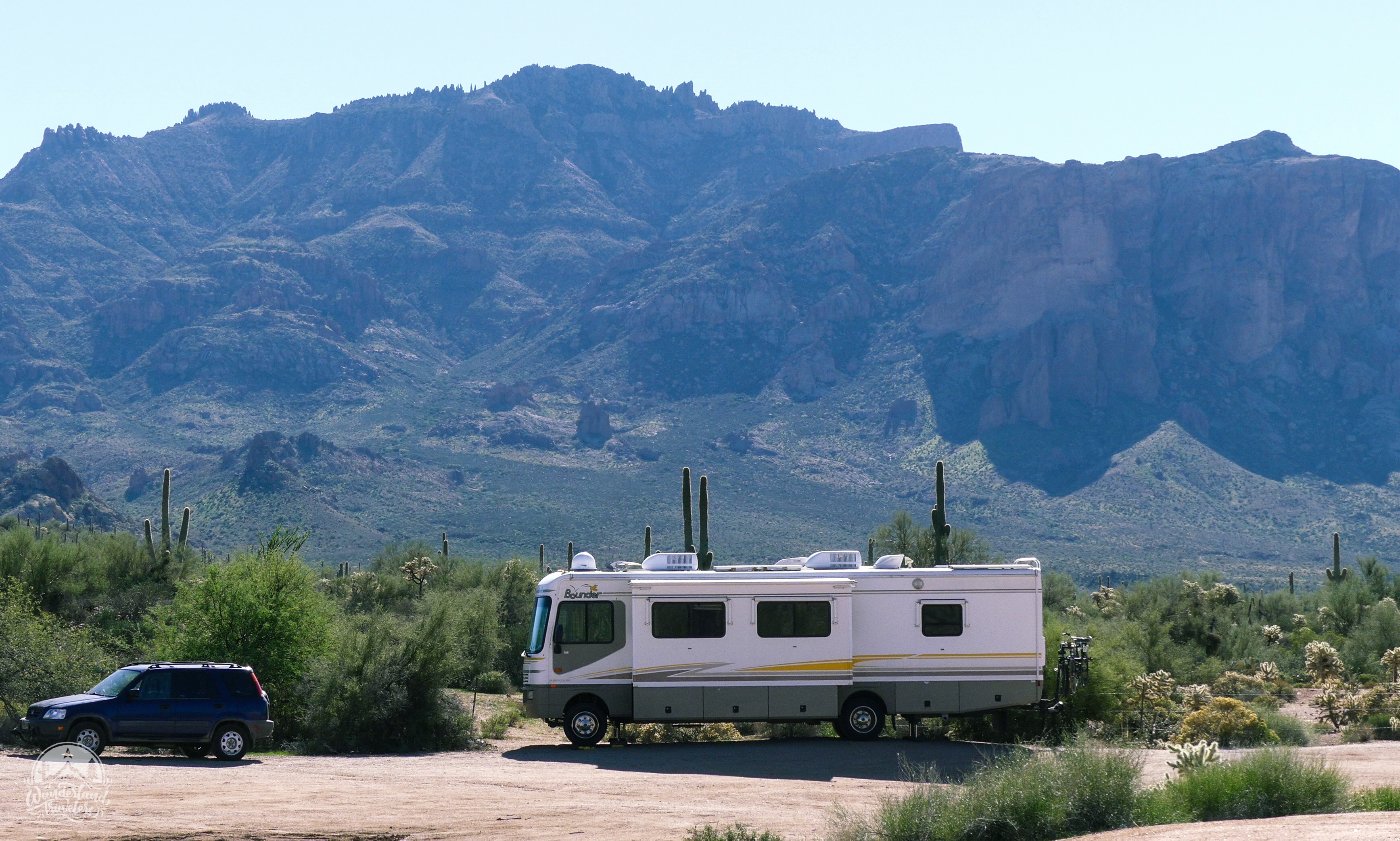 RV parked next to large mountains
