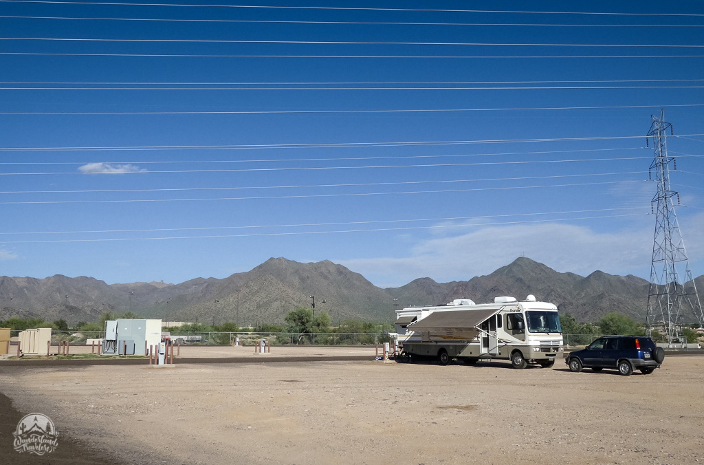 RV in a gravel lot under power lines